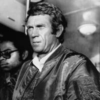 Actor Steve McQueen looks on during the shooting of his last movie 'The hunter' in 1980. Steve McQueen's descendants are suing Ferrari for marketing autos around the image of the iconic actor without compensating the family. The Italian sports car company profited unfairly from the actor's legacy in 2017 when it sold 'The McQueen,' a limited-edition model in connection with the 70th anniversary of Ferrari-branded cars, said the lawsuit, which was filed in the first week of August 2018 in a California state court. | AFP-JIJI