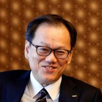 Mizuho Financial Group's new CEO Tatsufumi Sakai is interviewed at the company's headquarters in Tokyo on Monday. | REUTERS