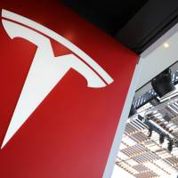 The Tesla logo is seen in Los Angeles in January. | REUTERS