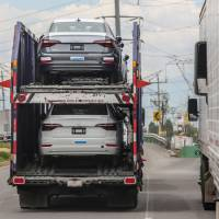 Trucks drive near the Volkswagen plant in Puebla, Mexico, on Monday. Mexican President-elect Andres Manuel Lopez Obrador's advisers on Monday hailed a new trade deal with the United States, saying it represented progress on energy and wages for Mexico's workers. | JOSE CASTANARES / VIA AFP-JIJI