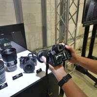 The Z system, with its larger lens mount, will allow the company to develop 'a new dimension in optical performance,' Nikon President and Representative Director Kazuo Ushida said at a news conference in Tokyo. | YOSHIAKI MIURA