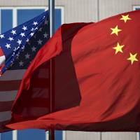 As analysts crunch trade data and political commentators dissect official statements for signs of how the Sino-American trade war will develop, some ordinary Chinese are using different sources to predict U.S. President Donald Trump's next moves: fortune tellers. | AP