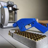 A Liberator pistol sits next to the 3D printer on which its components were made in Hanover, Maryland. U.S. President Donald Trump said Tuesday he was 'looking into' whether Americans should be able to print their own guns, dipping his toe into the latest contentious debate over the right to bear arms. | AFP-JIJI