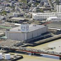 Mazda Motor Corp.'s headquarters plant in Fuchu, Hiroshima Prefecture, temporarily suspended operations after the deadly rains last month. Operations have since resumed, but railway services used by its workers have yet to be fully restored. | KYODO