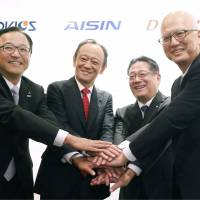 Presidents of four auto parts suppliers affiliated with Toyota Motor Corp. — Advics Co. Ltd., Denso Corp., Jtekt Corp., and Aisin Seiki Co. Ltd. — pose during a news conference in Nagoya, Aichi Prefecture, on Monday. | KYODO