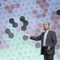 Masayoshi Son, chairman and chief executive officer of SoftBank Group Corp., speaks during a news conference in Tokyo on Aug. 6 to announce the company's first-quarter earnings. | BLOOMBERG