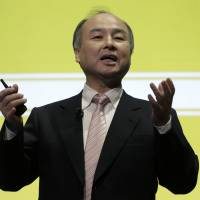 Masayoshi Son, chairman and CEO of SoftBank Group Corp., gestures at a news conference in Tokyo in February 2016. | BLOOMBERG