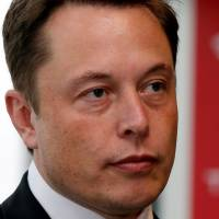 Tesla Motors Inc. Chief Executive Elon Musk holds a news conference in Tokyo in September 2014.   REUTERS