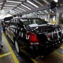 An employee checks on newly produced cars at a Toyota factory in Tianjin, China, in March 2012.