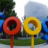 The brand logo of Alphabet Inc.'s Google is seen outside its office in Beijing in a photo taken with a fisheye lens. | REUTERS