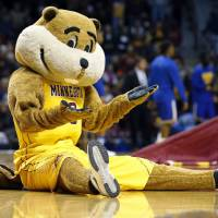 Minnesota mascot Goldy Gopher gestures to the crowd during the first half of an NCAA college basketball game against UMKC in Minneapolis in 2015. The university is among several that aggressively protects its trademark. It ordered a British liquor company to rename its Goldy Gin brand and abandon its trademark applications for the name, saying that consumers would think its products were licensed by the university. | ANN HEISENFELT / VIA AP