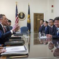 Economic revitalization minister Toshimitsu Motegi (right) discusses trade with U.S. Trade Representative Robert Lighthizer (center, left) and Trump administration officials in Washington on Thursday. | AP