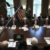 U.S. President Donald Trump and his team meet in the White House last week. Trump has prodded China to offer more at the bargaining table to head off an all-out trade war. | BLOOMBERG