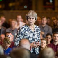 British Prime Minister Theresa May speaks during a question and answer session at Reece Group, an engineering firm in Newcastle, U.K., on July 23. | BLOOMBERG