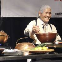 A Japanese chef demonstrates how to cook wagyu beef dishes at the Premium Japanese Food Showcase, which was organized by the Japan External Trade Organization, in Sydney on Monday. | KYODO