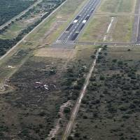 The wreckage of a plane that crashed with 97 passengers and four crew on board on takeoff at the airport of Durango, in northern Mexico, is seen Tuesday. | KEVIN ALCANTAR / DRONES DURANGO / VIA AFP-JIJI