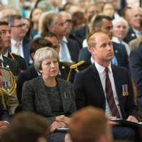 Prince William Duke of Cambridge and British Prime minister Theresa May attend a religious ceremony to mark the 100th anniversary of the World War I Battle of Amiens, at the Cathedral in Amiens, France, Wednesday. The Battle of Amiens sounded the start of the Hundred Days Offensive on the Western Front, which led to the Armistice in November 1918. | SEBASTIEN COURDJI / POOL / VIA AFP-JIJI