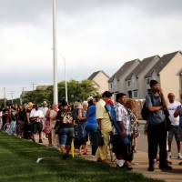 People wait in line outside the Charles H. Wright Museum of African American History where the late singer Aretha Franklin will lie in state for two days of public viewing in Detroit Tuesday. | MIKE SEGAR / VIA REUTERS