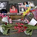 A makeshift memorial is seen at the nameplate for singer Aretha Franklin outside the Apollo Theater in the Harlem section of New York City Thursday.