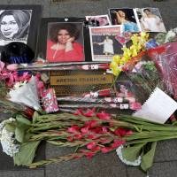 A makeshift memorial is seen at the nameplate for singer Aretha Franklin outside the Apollo Theater in the Harlem section of New York City Thursday. | AP