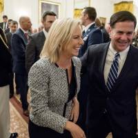 Homeland Security Secretary Kirstjen Nielsen and Arizona Gov. Doug Ducey depart an event to salute U.S. Immigration and Customs Enforcement (ICE) officers and U.S. Customs and Border Protection (CBP) agents in the East Room of the White House in Washington on Aug. 20. | AP