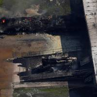 A fire burns at the flooded plant of French chemical maker Arkema SA on Aug. 31, 2017, in Crosby, Texas, after Tropical Storm Harvey passed. | REUTERS