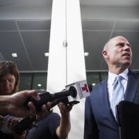 Attorney Michael Avenatti talks to the media Tuesday in Houston. Avenatti, the attorney taking on President Donald Trump on behalf of adult film star Stormy Daniels, offered some details on his policy views Tuesday as he weighs an outsider Democratic bid for the White House. | MARIE D. DE JESUS / HOUSTON CHRONICLE / VIA AP