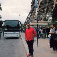 In this undated photo published Monday by Spanish journal La Vanguardia, Omar Hichamy, one of the terrorists that committed several attacks in Barcelona and Cambrils last Aug. 17, poses close to the Eiffel tower in Paris. | LA VANGUARDIA / VIA AFP-JIJI