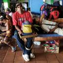 Venezuelans rest next to their belongings at a bus terminal after being expelled from the Pacaraima border control point by Brazilian civilians, in Santa Elena, Venezuela, Sunday.