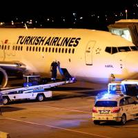 A fireman is seen entering the cargo compartment of a Turkish Airlines flight parked on the tarmac of Budapest Airport Wednesday after one terminal of the airport and its surroundings were briefly shut down as the Disaster Management Authority ordered an investigation due to an overheated container carrying an isotope on an incoming flight. Neither the airport nor the disaster control authority confirmed that the flight affected was operated by Turkish Airlines.   REUTERS
