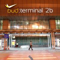 A man walks in front of Budapest Airport's terminal 2B Wednesday after one terminal of the airport and its surroundings were briefly shut down as the Disaster Management Authority ordered an investigation due to an overheated container carrying an isotope on an incoming flight.   REUTERS