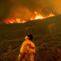 California's raging Carr wildfire causes another death