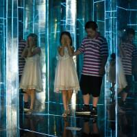 Children visit a maze constructed with mirrors at a mall in Beijing on Thursday. | AFP-JIJI