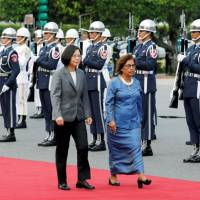 Taiwan President Tsai Ing-wen (left) and Marshall Islands leader Hilda Heine review an honor guard at a welcoming ceremony in Taipei on July 27. | REUTERS