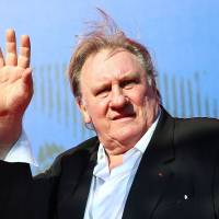 Gerard Depardieu waves as he arrives during a red carpet event for the movie 'Novecento — Atto Primo' at the 74th Venice Film Festival in Venice, Italy, last September. | ALESSANDRO BIANCHI / VIA REUTERS