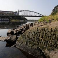 One of the 'hunger stones' revealed by the low level of water in the Elbe River is seen in Decin, Czech Republic, Wednesday. | DAVID W CERNY / VIA REUTERS