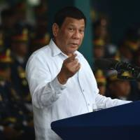 Duterte calls 'wrong' China's claim to airspace and waters around islands in South China Sea