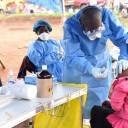 A health worker administers an Ebola vaccine to a woman in Congo's North Kivu province on Saturday.