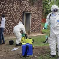 Congolese health officials prepare to disinfect people and buildings at the general referral hospital in Mbandaka, Congo, May 31. At least four new cases of the Ebola virus have emerged in Congo's northeast, just a week after an outbreak in the northwest was declared over, the country's health ministry said Wednesday.   AP