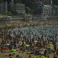 Asphalt melts and dogs don shoes as Europe wilts under heat waves
