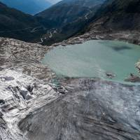 This aerial view shows a glacial lake a the end of the Rhone Glacier, near Gletsch, Switzerland, on Friday as a heatwave sweeps across northern Europe.   AFP-JIJI