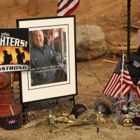 A memorial for Jeremy Stoke of the Redding Fire Department, in Redding, California, is seen Aug. 10. The California Department of Forestry and Fire Protection says in a report that Redding firefighter Stoke, 37, died July 26, after he was enveloped in seconds by a fire tornado with a base the size of three football fields and winds up to 165 mph. | AP