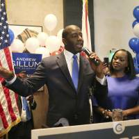Andrew Gillum with his wife, Jai Gillum, at his side addresses his supporters after winning the Democrat primary for governor on Tuesday in Tallahassee, Florida. | STEVE CANNON / VIA AP