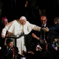 Pope Francis waves as he leaves after attending the Festival of Families at Croke Park during his visit to Dublin, Ireland, on Saturday. | REUTERS
