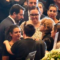 Italian Interior Minister Matteo Salvini (left) meets relatives of the victims of the collapsed Morandi highway bridge ahead of a funeral service in Genoa on Saturday. | AFP-JIJI