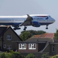 A British Airways Boeing 747 comes in to land at Heathrow Airport in London on June 25. | REUTERS