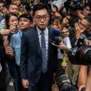 Andy Chan (center), founder of the Hong Kong National Party, is surrounded by members of the media as he leaves the Foreign Correspondents' Club in Hong Kong on Tuesday.