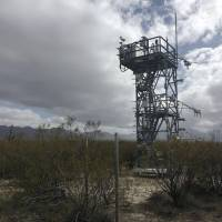 A tower used to measure carbon dioxide flows over a large area is seen in February south of Tucson, Arizona. Observations from across the globe show that as temperatures have warmed, bacteria and fungi in the soil are becoming more active. These turbo-charged microbes are feeding on dead leaves and plants, releasing more heat-trapping carbon dioxide into the air, according to a study in the Aug. 1 edition of the journal Nature. | RODRIGO VARGAS / VIA AP