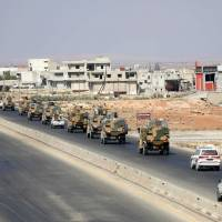 Turkish forces are seen in a convoy on a main highway between Damascus and Aleppo, near the town of Saraqib in the northern Idlib province, on Wednesday. Russian Foreign Minister Sergey Lavrov said in a press conference that there is 'full political understanding' between Russia and Turkey, who support opposing sides of the Syrian civil war but are currently in intense negotiations to ensure Idlib does not become a breaking point in their alliance. | OMAR HAJ KADOUR / VIA AFP-JIJI