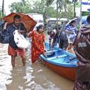 Flood victims are evacuated to safer areas in Kozhikode, in the southern Indian state of Kerala, Thursday. Torrential monsoon rains have disrupted air and train services in the southern Indian state of Kerala, where flooding, landslides and bridge collapses have killed dozens of people in the past week, officials said.